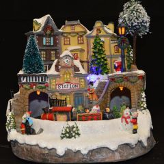 Image of Christmas Village Railway Station Scene With Moving Train