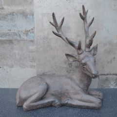 Image of Candlelight Resin Sitting Stag - Brown - 34.5cm